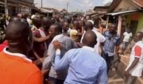 Vanguard photo-journalist, Mr Akpokona Omafuaire being mand handled by Delta State LGA Boss