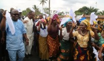 Governor Emmanuel Uduaghan of Delta State (left) dancing with the excited crowd on arrival to commission the 7.1 Km Umeh road in Isoko South Local Government Area constructed by the State government.