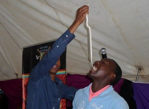 Pictures last week depicting Mnguni allegedly feeding a live snake to one of his followers have gone viral on social media