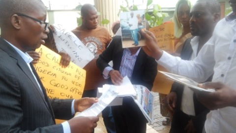 DPP official Barr Champion Umukoro recieving a copy of the   petition from the protesting youth from Okurighwer community in Sapele, at   the DPP office at Asaba Delta State.