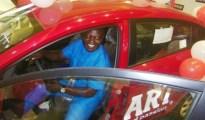 HON. JONATHAN AMITAYE TESTING THE RIO KIA CAR WHICH HE WON UNDER CAMPARI SHOPRITE RAFFLE DRAW PROMOTION