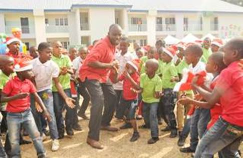 The General Manager, Offshore Assets of the Shell Nigeria Exploration and Production Company Limited (SNEPCo), Mr. Effy Okon, in a dance with pupils of the Innercity Mission School, Ikeja, Lagos, at the SNEPCo-sponsored 2015 Christmas party... on Monday.
