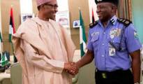 President Muhammadu Buhari exchanging pleasantry with new Inspector General of Police Alhaji Katungi Ibrahim