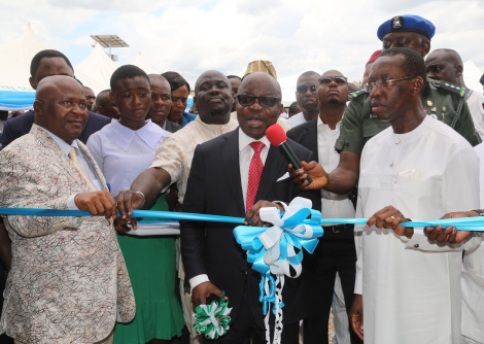 Delta State Governor, Senator Ifeanyi Okowa (right); the Immediate Past Governor, Dr. Emmanuel Uduaghan (middle); Speaker, State House of Assembly, Rt. Hon. Monday Igbuya (left) and Other Dignitaries, during the Commissioning of Ogbemudein Model Secondary School Agbor, Ika-South Local Government Area, Delta State.