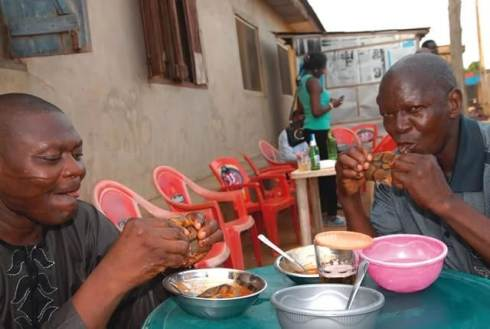 Lagosians feasting on snake peppersoup in Lagos beer palour