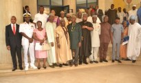 A photograph of the Hon Minister of Transportation with some National Assembly members and members of the Board of the Nigerian Maritime Administration and Safety Agency (NIMASA) after the inauguration of the Board in Abuja.