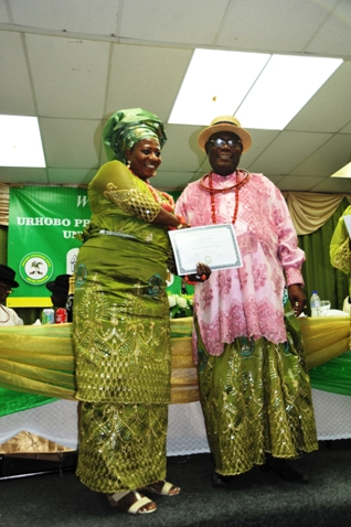 Lady Vice President of Urhobo Progress Union (UPU) United Kingdom Branch, Mrs Tiona  Agbaisa recieving certificate of recorgnition from UPU President World Wide, Chief Joe Omene