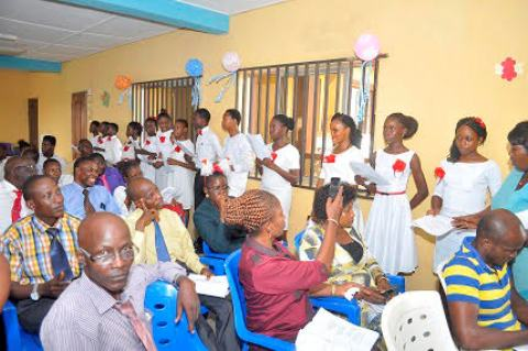 Cross section of PTA members of the school and visitors celebrating with the students