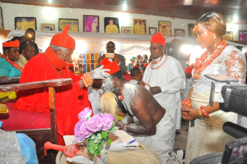 Chief Bright Apinoko receiving chiefaincy crown from HRM Ohworode of Olomu Kingdom