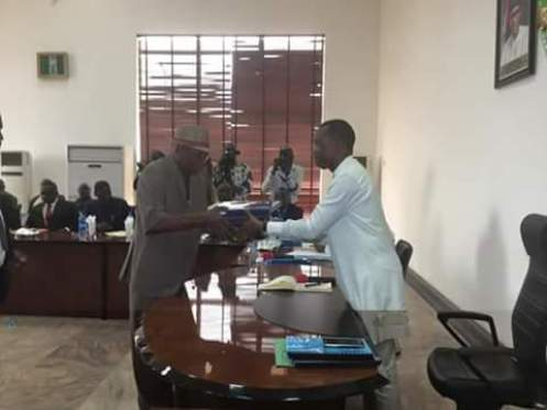 Prof Abednego presenting the reports to Gov. Okowa