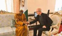 Buhari shaking hands with the iconic Christian leader