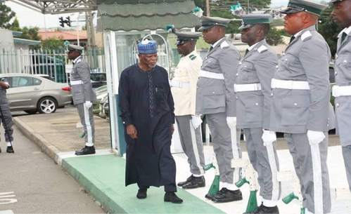 Boss of Nigerian Custom Service, Col Hameed Ali inspecting guard of honour mounted by officers of Nigeria Custom Service on mufti