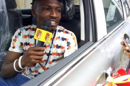 Efe Emmanuel Ejeba in his brand new SUV JEEP