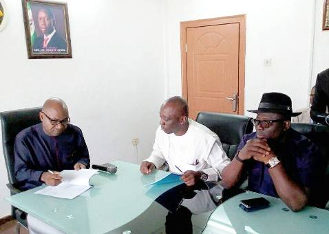 L-R Secretary to Delta State Government, Hon Ovie Agas signing the MOU on-behalf of Delta State Government while Delta Attorney General and Commissioner for Justice, Hon Peter Mrakpor (in white) and member representing Okpe Constituency at the State House of Assembly, Hon Sheriff Oborivwori watches with keen interest.