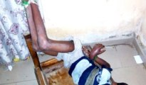 12 year-old Tobi tied to a window protector by his father
