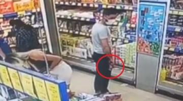 Alışveriş yapan kadının gizlice fotoğraflarını çeken kişi kamerada