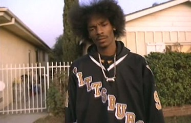 """The look that started it all: Snoop and his Pittsburgh Penguins jersey from the """"Gin and Juice"""" video."""