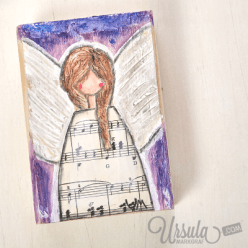 Angel on wooden block