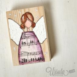 Angel on wooden block
