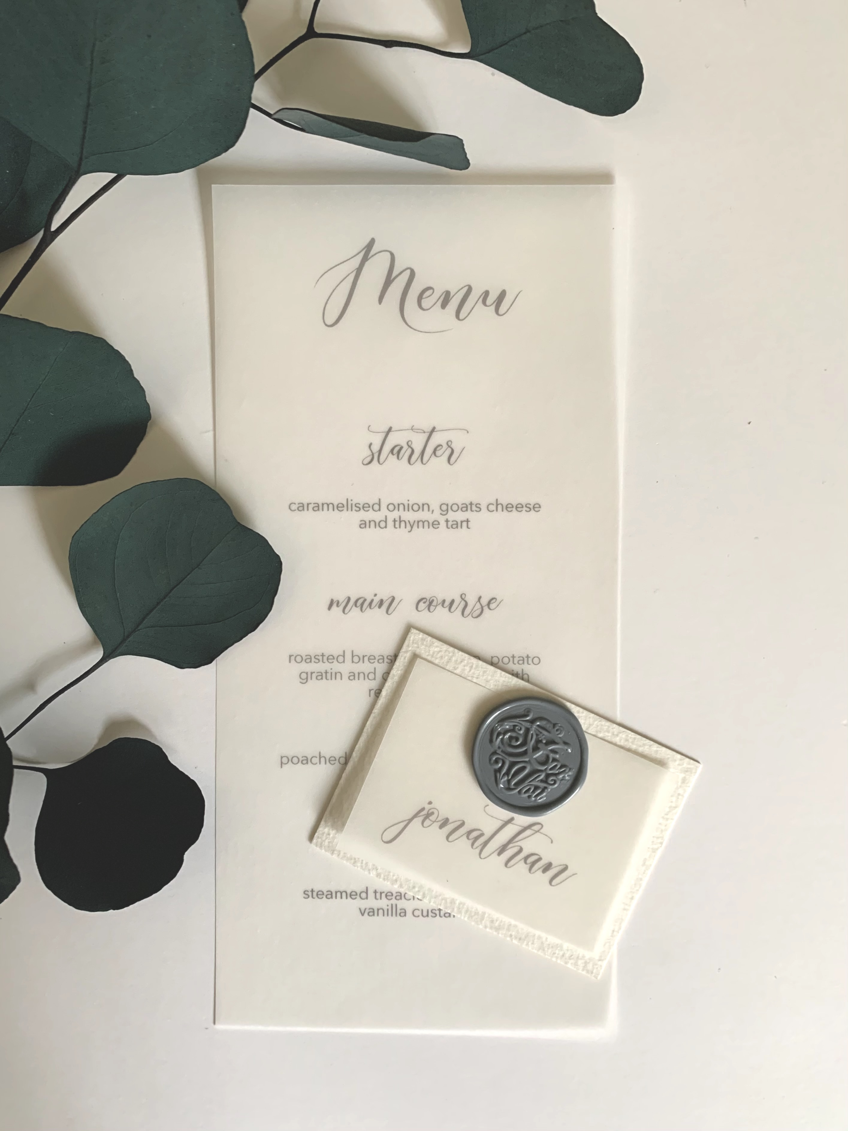 Menu printed onto vellum with layered vellum placecard including wax seal