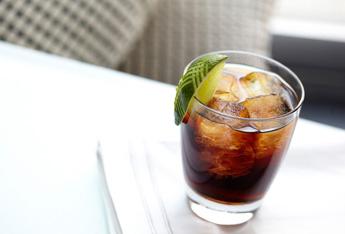 dark rum cola rocks lime hero
