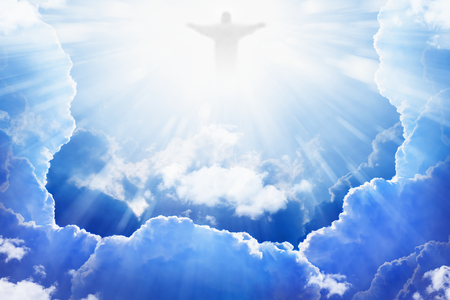 god: Jesus Christ in blue sky with clouds, bright light from heaven, resurrection, easter