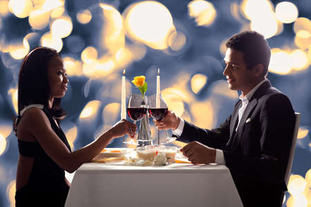 Portrait Of Romantic Couple Toasting Red Wine At Dinner Stock Photo - 19399927