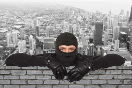 SECURITY NINJA: Roofers. Ninja against the backdrop of the city