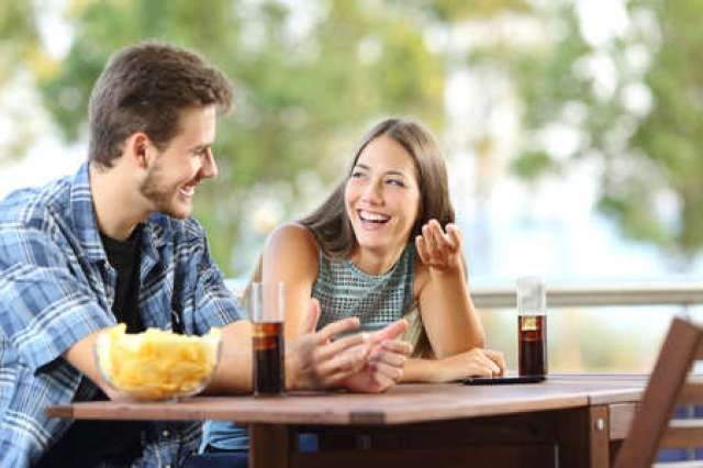 Girl talking with a friend in a terrace with snacks and drinks Stock Photo - 52407667