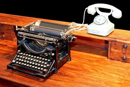Vintage black typewriter and old white phone Stock Photo - 2968910