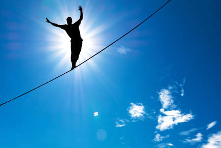 Man balancing on the rope concept of risk taking and challenge Stock Photo - 46627370