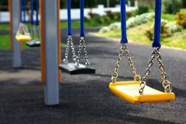Empty playground swings in a row Stock Photo - 3146935