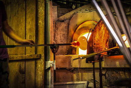 glass blowing workshop: Glassworks glass manufacturing process.Murano,Italy