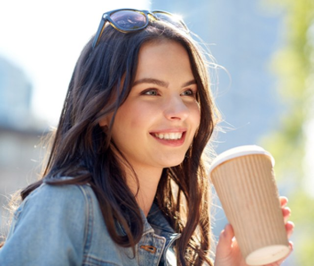 Drinks And People Concept Happy Young Woman Or Teenage Girl Drinking Coffee From Paper Cup