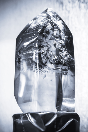 quartz crystal: Blue toned photo of natural transparent quartz crystal, selective focus