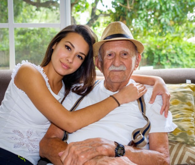 Elderly Eighty Plus Year Old Man With Granddaughter In A Home Setting