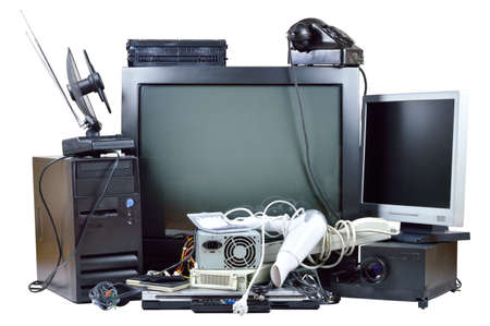 Old and used electric home waste  Obsolete pc computer, telephone, CRT monitor, DVD  Stock Photo - 21802483