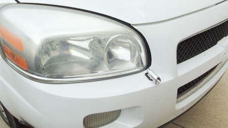 White CarAuto headlight and front bumper