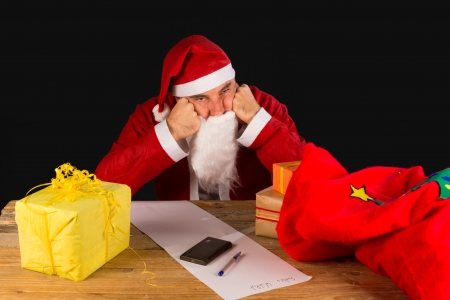 XMAS GRINCH: A sulky Santa completely fed up with the holiday season Stock Photo