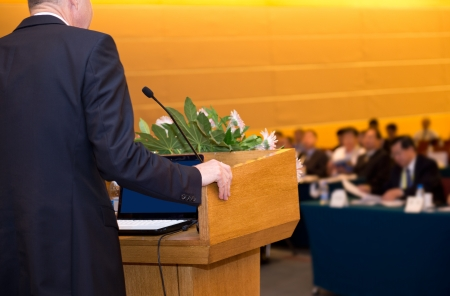 Business man is making a speech in front of a big audience at a conference hall. Stock Photo - 18722663