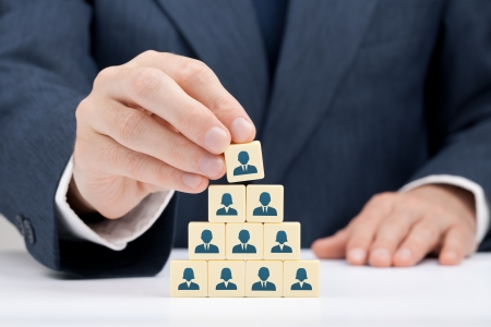 Human resources and corporate hierarchy concept - recruiter complete team by one leader person  CEO  represented by icon  Foto de archivo - 20215027
