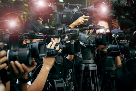 media: press and media camera ,video photographer on duty in public news coverage event for reporter and mass media communication