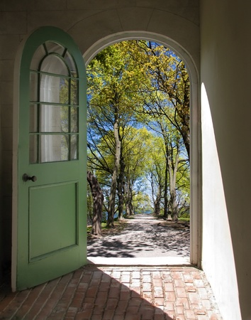 Arched doorway opening on path lined with spring trees Stock Photo - 12252958