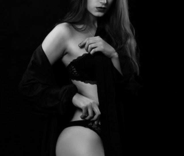 Sensual Strip Tease Woman In Lingerie On Black Background Looking At Camera Stock Photo 101859513