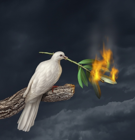 war: Peace crisis concept with a white dove standing on a tree holding an olive branch on fire as a symbol of the challenges of war fighting and revolution and the elusive search for a truce or agreement in the middle East or other countries in conflict