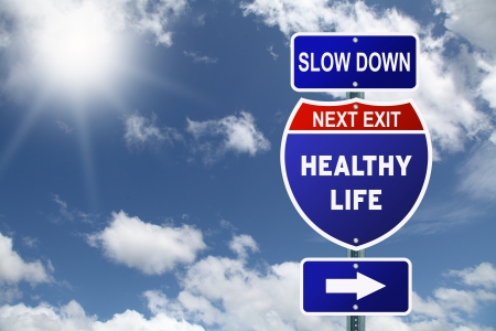 Motivational Interstate road sign slow down healthy life next exit Stock Photo - 17536653