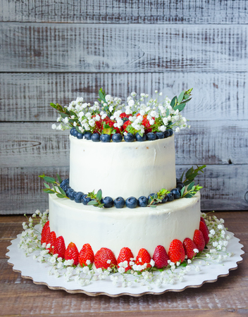 Two tier Cream Cheese Wedding Cake With Blueberries And Strawberries     Stock Photo   two tier cream cheese wedding cake with blueberries and  strawberries