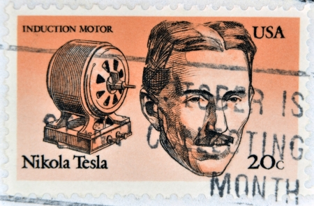 UNITED STATES OF AMERICA - CIRCA 1983: A stamp printed in USA shows Induction motor and portrait of Nicola Tesla, inventor, electrical engineer and mechanical, circa 1983 Stock Photo - 21273634