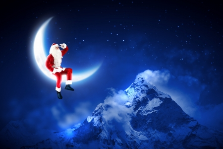 Santa Claus sitting on shiny moon above winter forest Stock Photo - 16616637