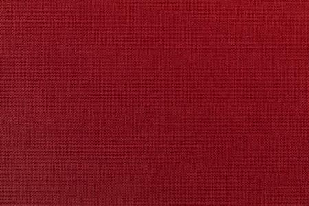 fond rouge fonce a partir d un materiau textile tissu avec texture naturelle tissu toile de fond